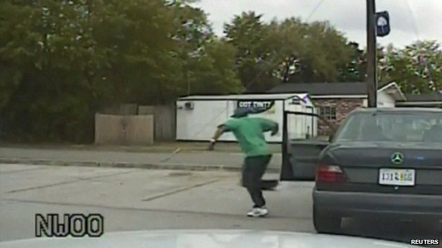 Still from police dash cam video showing shooting victim Walter Scott running from his car