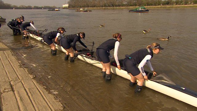 Members of Oxford's women's boat race team with their boat