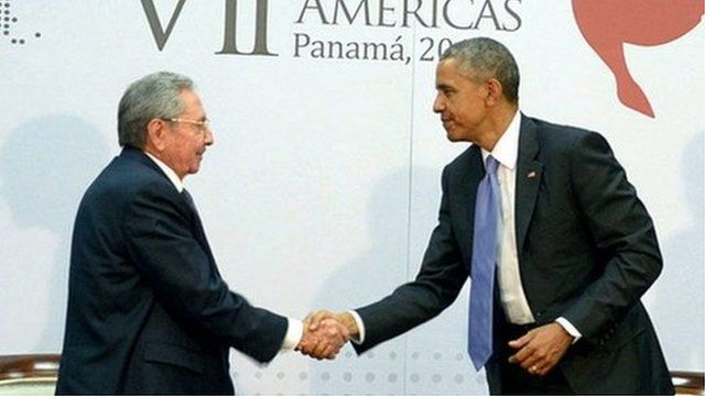 US President Barack Obama (R) shaking hands with Cuban President Raul Castro