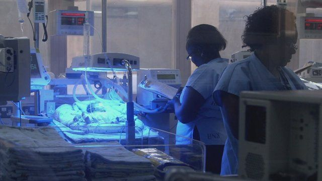 A maternity ward, with a baby in an incubator