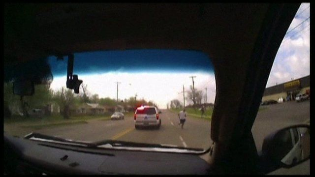 View from police vehicle as Eric Harris runs away from officers