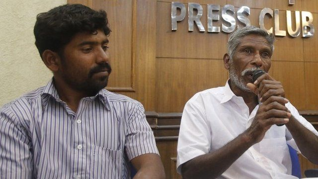 Indians Balachandran (L) and Sekar (R) - only names given - both claiming to be eyewitnesses of a police encounter, attend a press conference in New Delhi