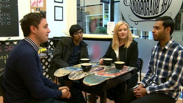 Steffan Messenger talks to young people in a coffee shop