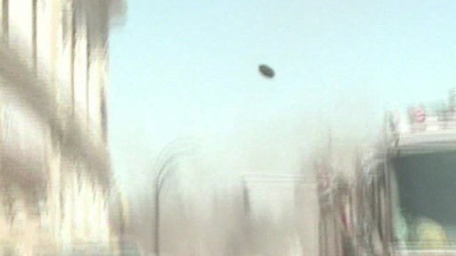 A manhole cover is blasted some 200 ft into the air after an explosion