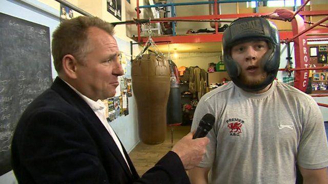 Jamie Owen talks to a boxer in Swansea