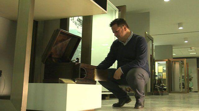 Man looking at gramophone