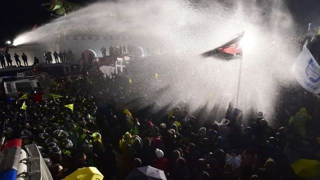 Protesters sprayed with a water cannon by police at a rally in Seoul, held to remember the Sewol ferry disaster victims