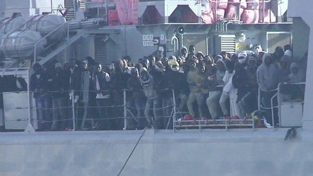 Migrants on a coastguard ship