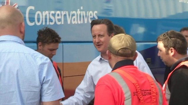 David Cameron shakes hands with workers