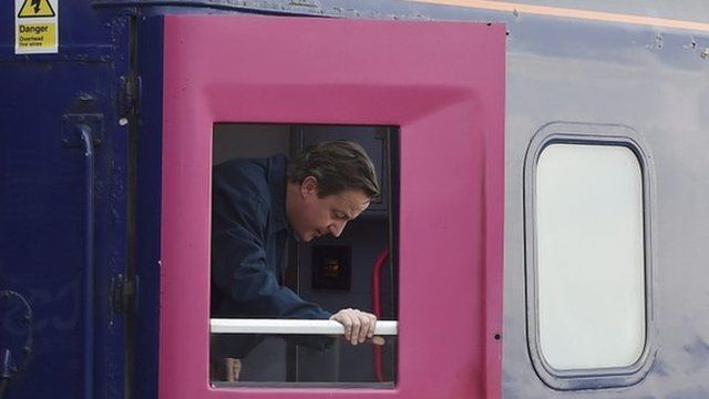 David Cameron leaving the sleeper train
