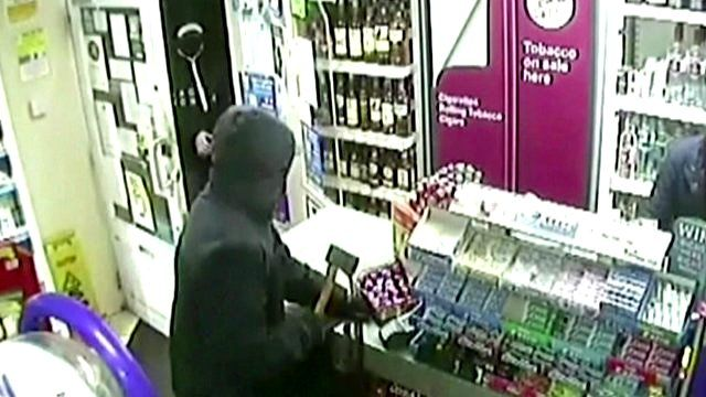 Shop robber uses axe to threaten staff