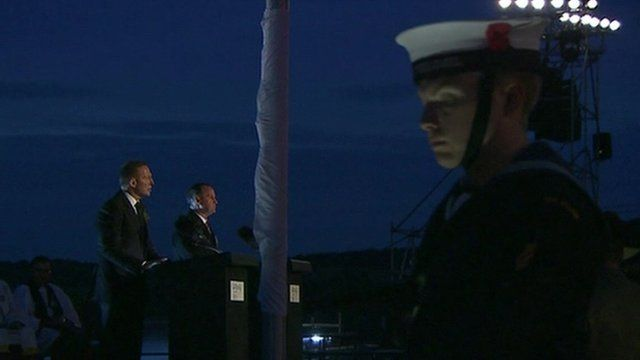John Key and Tony Abbot with a naval officer in foreground
