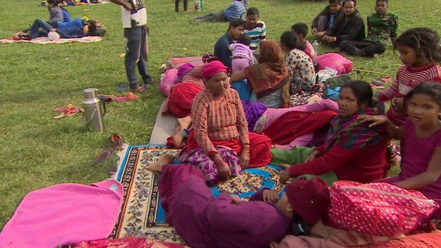 Nepal residents camping in a playground in Kathmandu