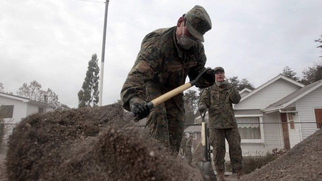 Soldiers help clean up following volcano eruption