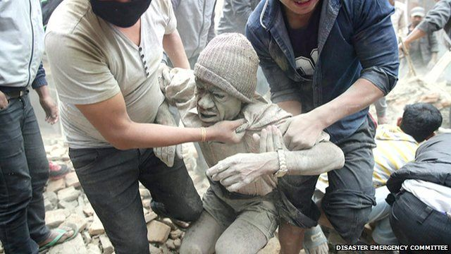 A man being pulled out of rubble