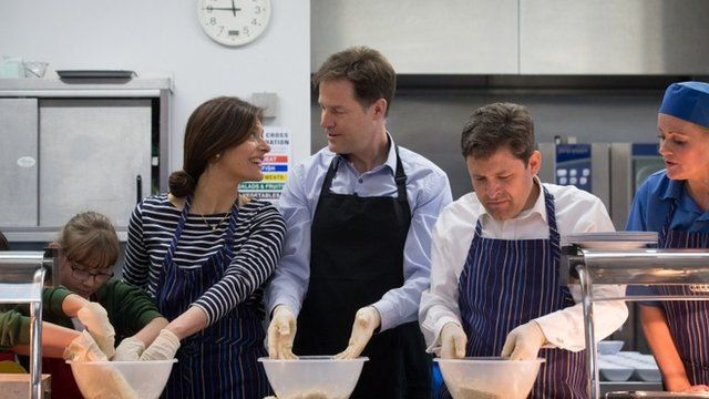 Deputy Prime Minister Nick Clegg (C) and his wife Miriam Gonzalez Durantez help make a crumble at Ivy Lane Primary Schoo