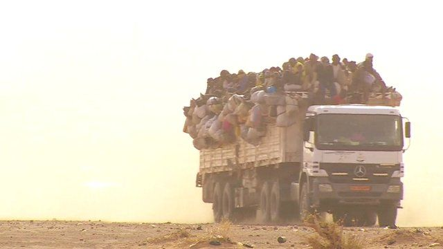 A truck carrying migrants