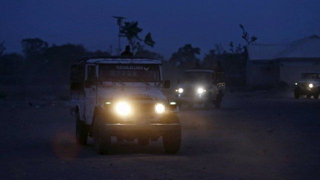 Jeeps bring people to a refugee camp in north-eastern Nigeria