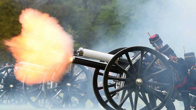 Flash from gun carriage as gun fires during royal salute in London's Hyde Park
