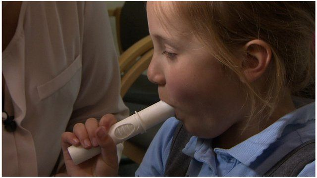 Child performs breath test
