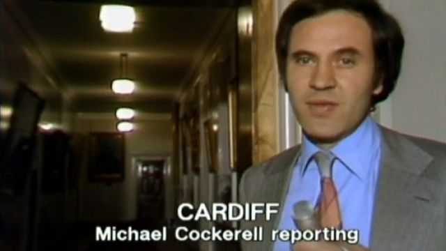 BBC reporter Michael Cockerell lurks in a corridor at Cardiff City Hall, hoping to catch Prime Minister James Callaghan - 3 May 1979