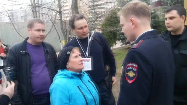 Woman seen apparently trying to stuff ballots in Moscow election