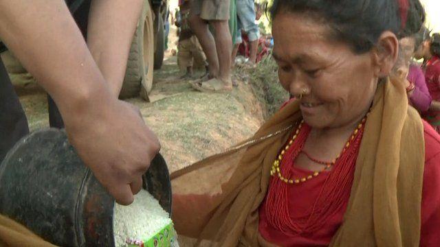 Woman receiving rice