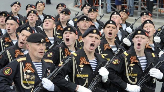 Servicemen march during the Victory Day parade in Vladivostok, Russia