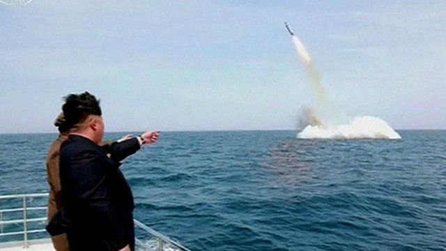 Kim Jong-un watches key submarine missile launch