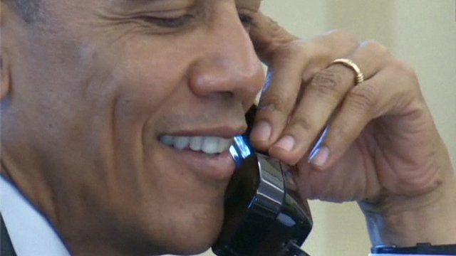 President Obama on the telephone