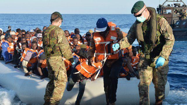 Marines help migrants on board