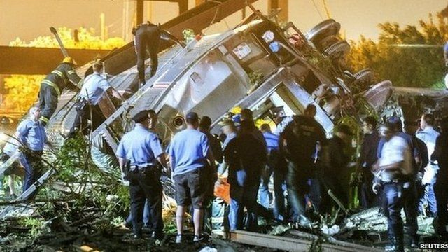 Rescue workers at the crash scene. Photo: 12 May 2015