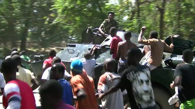 Thousands take to the streets in Burundi after a senior army general announces a coup