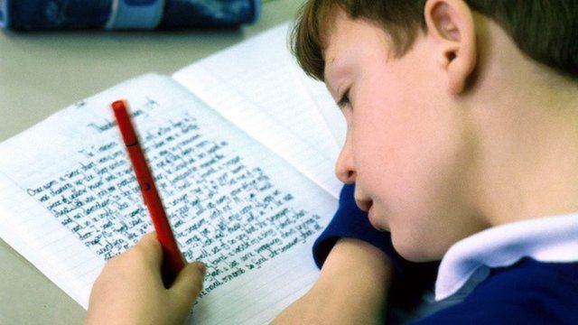 Child writing in book