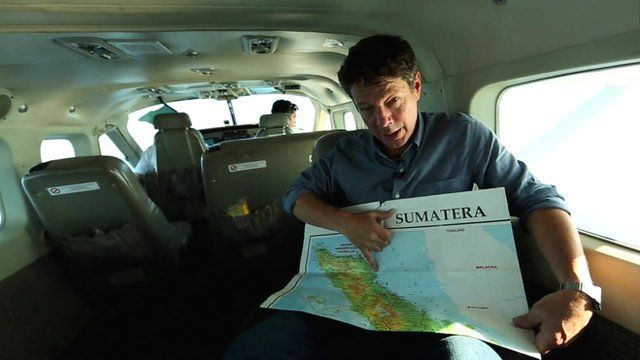 Ian Pannell in plane pointing at map of area