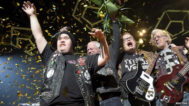 Members of Finnish punk rock band PKN celebrating winning a place in the Eurovision Song Contest