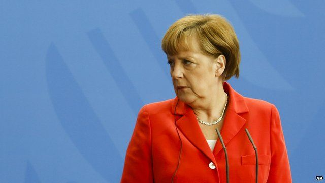German Chancellor Angela Merkel looking right