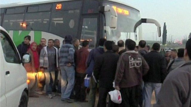 Palestinians getting on bus - library image