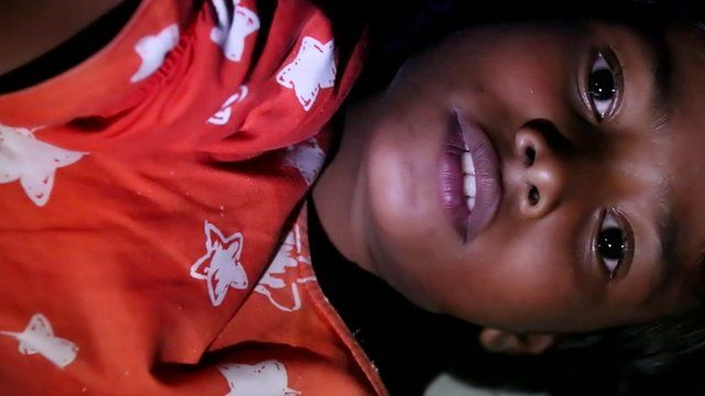 Close up of child Rohingya Muslim refugee, Rashida, in a camp for migrants in Indonesia