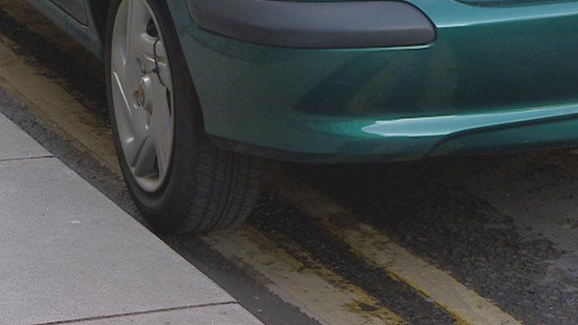 Car parked on a double yellow line