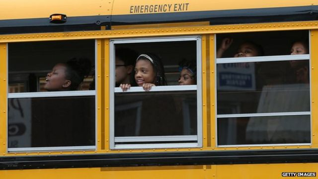 How do US black students perform at school?