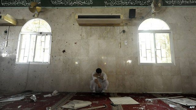 Man against wall of mosque following attack