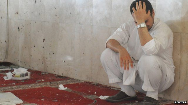 Family member mourning at scene of attack in a Saudi mosque on Friday