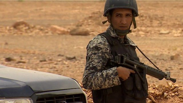 Armed Jordanian soldier in the country's desert brigade on duty near border with Iraq