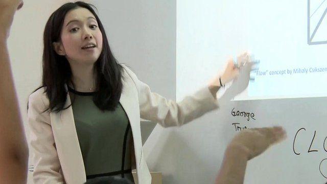 Michelle Sun teaching Hong Kong children computer coding skills