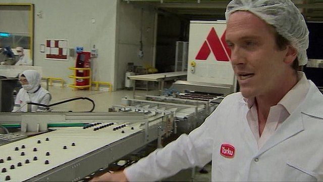 Mark Lowen in hairnet on chocolate production line