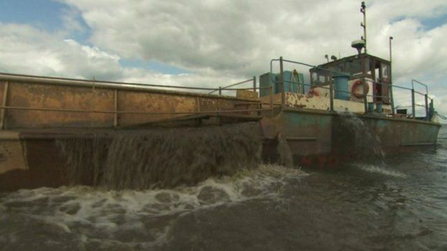 Sand is dredged onto boats from the bottom of Lough Neagh, as Conor Macauley reports