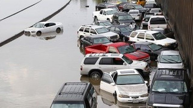 Car stranded and abandoned in floodwater