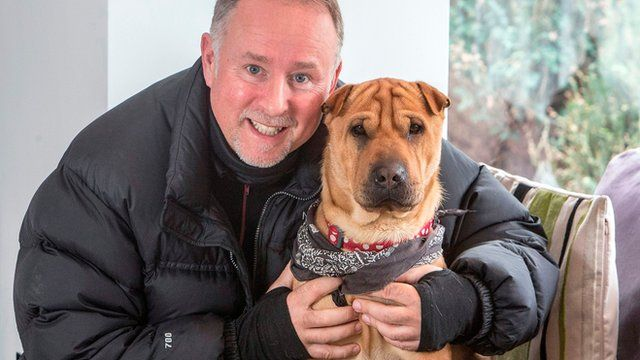 Ian Russell with the dog he rescued dog, Kai