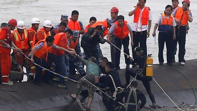 A survivor is rescued by divers from the Eastern Star vessel which sank in the Yangtze River - 2 June 2015